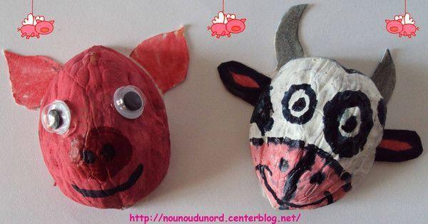 Animaux de la ferme en coquille de noix vache et cochon