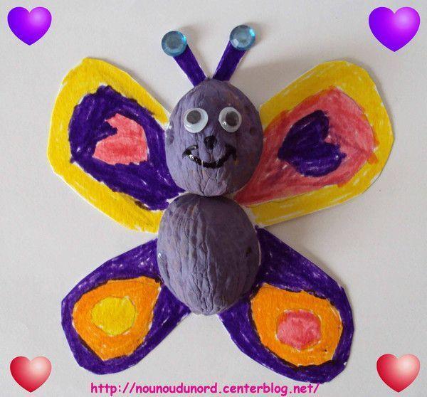 Papillon  réalisé avec des coquilles de noix