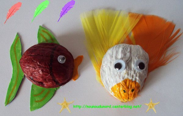 Poisson et oiseau réalisés avec les coquilles de noix